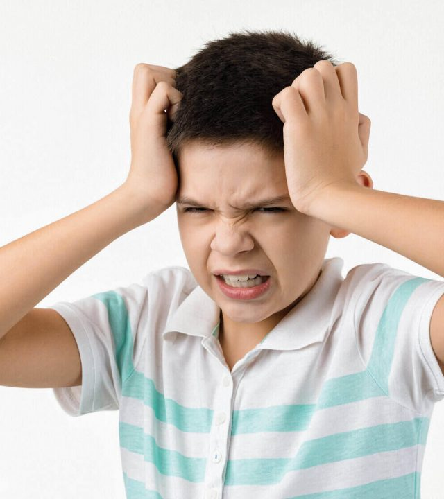angry screaming little child boy mad frustrated and furious. Human emotions and facial expression